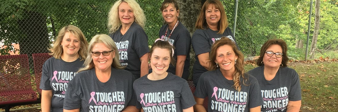 Central Office staff sports their Tomcats for a Cure t-shirts.