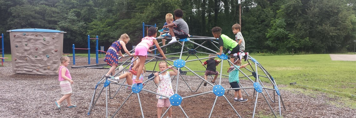 Camp Kindergarten students enjoying play time outside.